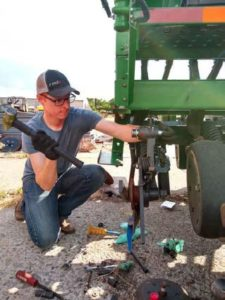 Jesse Faul working on a John Deere no-till drill in Ukraine